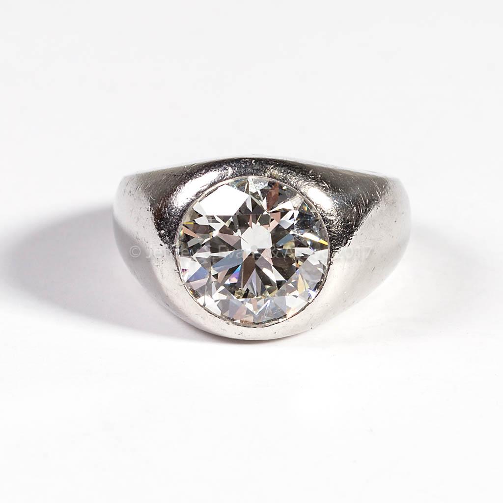 VINTAGE PLATINUM AND 5 CARAT DIAMOND SOLITAIRE RING
